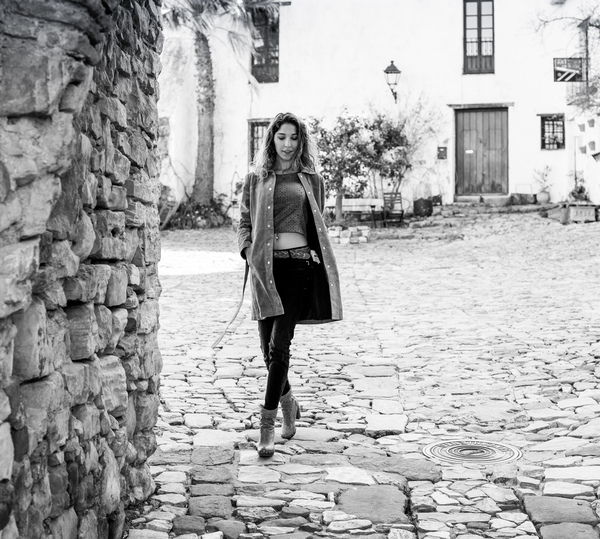 At the village: Young woan walking in a typical village of Spain.