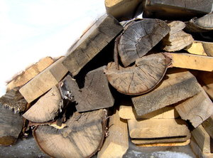 Waiting for a Fire: A shot of my wood pile in my back yard. Too bad its all wet though, I would love to have a fire.