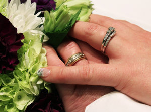 Embrace: A photo of a wedding ring embrace. Ah.... love is in the air.