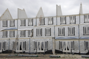 Building new houses in Brielle: New houses, with the material for isolation on the facade
