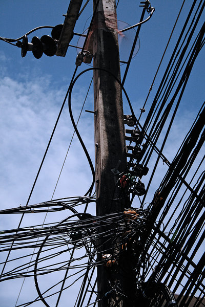 Power Lines: Photo of an electricity pole with lots of wires.
