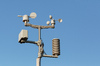 Weather station: A close-up picture of a small weather station with a clear blue sky in the background..