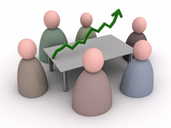 Meeting: Better Results: An abstract picture of persons in a meeting. The subject of the meeting is made visible by a green graph line to achieve better results.