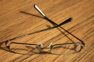 Glasses: Pair of glasses resting on a table
