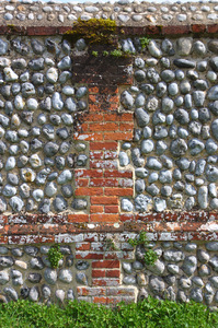 An interesting wall: An old wall made of a mixture of brick and Norfolk flints, creating an interesting mix of textures. In grounds of Felbrigg Hall, Norfolk.