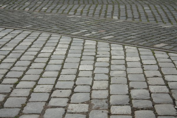 Tram tracks in cobbles: Close-up of tram lines in old cobbles outside a former tram depot