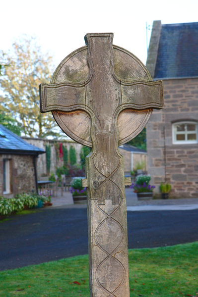 Celtic Cross: Wooden Celtic Cross at Bield Christian retreat centre, near Perth, Scotland
