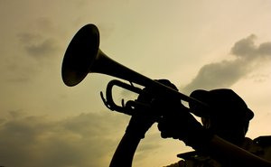 Bugle Call: A trumpet player from the local