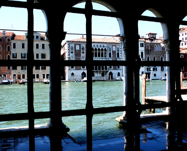 Through iron bars: View on Venice canal through iron bars