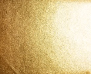 Golden Canvas Texture: A canvas painted with highly reflective gold paint.
