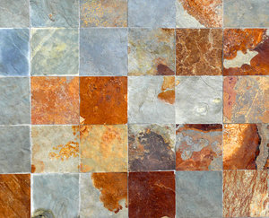 Cut Stone Tiles: Colorful stone tile facing on the side of the wall of a book store.