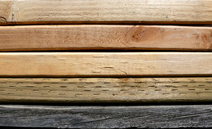 Grades of 2x4 Lumber: Various grades of two by four boards in a stack.