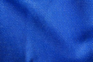 Blue Nylon Webbing texture: The fabric back of a folding chair made for going to the beach.