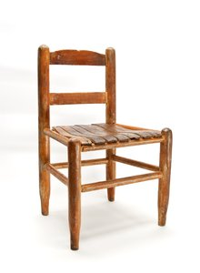 Old School Child's Chair: This old wooden chair has one more generation left in its usefulness. It measures only 22 inches at the top of the back and 12 inches at the seat.