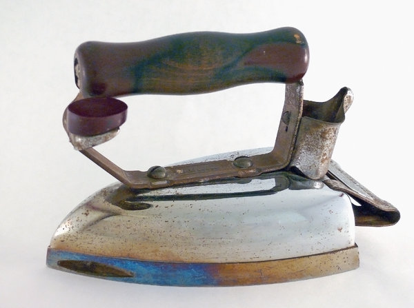 Clothes Iron: An old fashioned plug in electric iron, isolated on a plain background. You may like: http://www.rgbstock.com/photo/2dme9iF/Apothecary+Jar  or:  http://www.rgbstock.com/photo/mJsLhcU/Wooden+Clothespin