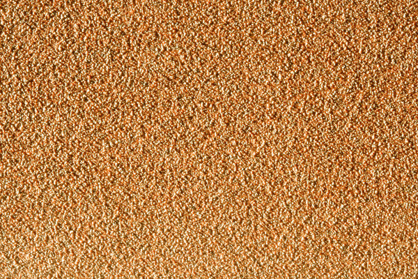Sandpaper Texture: A close-up of a sandpaper belt for a belt sander.