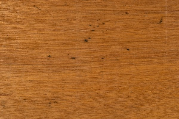 Laminate Wood Texture: A view of the grain pattern from the inside surface of a sliding door from a cheap cabinet. The wood has a mosaic like grain pattern from being peeled off of the log to make the thin laminate.