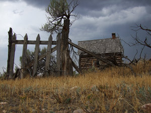 Old house: A very old house in a desert scene in front of a stormy sky
