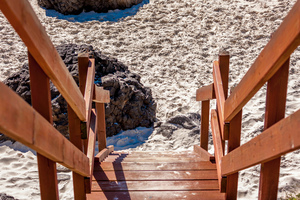 Kirra Beach Qld: A number of wooden stairways are located along the footpath/roadway area and give access to pedestrians to access the sandy beach at Kirra Queensland Australia.