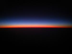 sunset from a plane: sunset near on dusk. photo taken from a plane flying out of Sydney NSW Australia