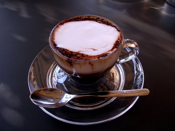 Strong Coffee: A small cup of coffee and chocolate at an Italian cafe.