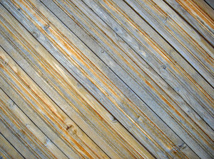 Diagonal fence: Country house fence deteriorated