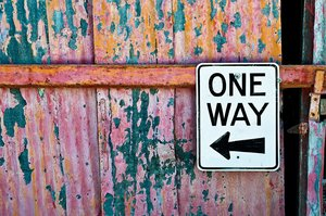 One Way: One Way sign on a rickety old shack in Jerome, Arizona.