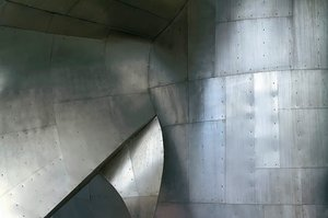 Sheet metal, rivets and seams: A section of a wall at the Experience Music Project in Seattle.