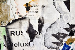 Seattle grunge: Some details from a wall of old worn posters in a Seattle alley.
