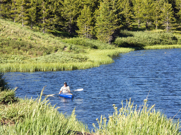 Kayak in a mountain lake: Kayak in a high Colorado mountain lake.