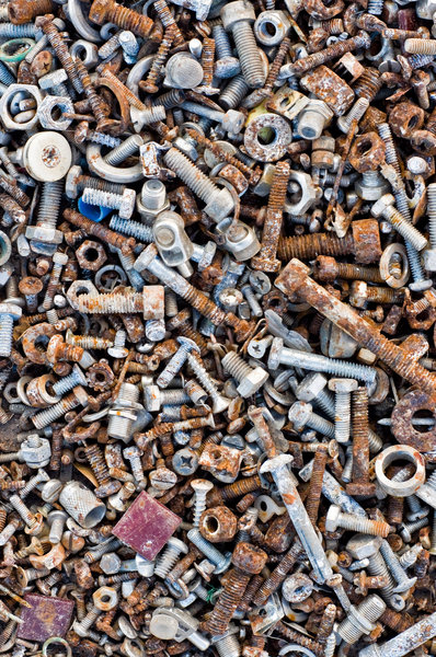Nuts, bolts and screws: Texture from a pile of rusted bolts and screws.