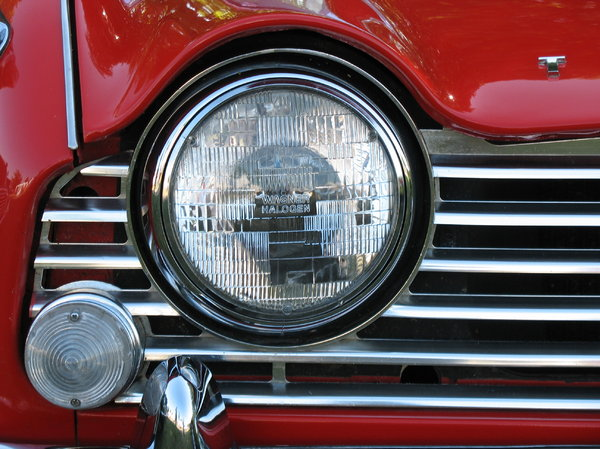 headlamp: headlamp of a red vintage triumph.