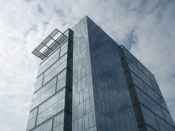 condo tower: a condominium tower of blue glass.