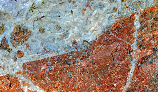 Rock Texture: Shown here is a matrix of feldspar and quartz showing some veinlets