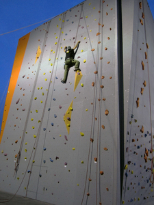 adventure: Athlete climbing the wall..