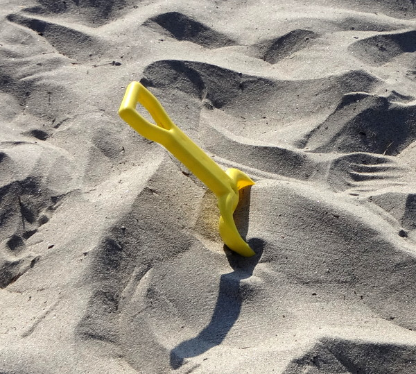 Shovel in the Sand: a shovel left behind in the sand