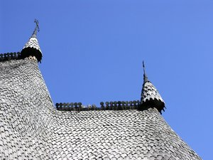Romanian wooden churches: Romanian wooden churches. The wooden tiles roof is precisely cut out of the summer blue sky.You can check the museum at: http://www.muzeul-etnogra ..