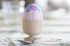 Egg: Painted egg in egg holder with a spoon,