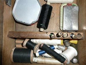 Sewing Supplies: Sewing supplies in a drawer of an old sewing machine