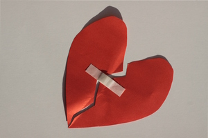 Healed heart: Heart with a band-aid