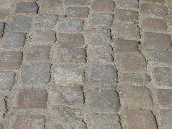 Cobblestone Pavement 2: Cobble stone pavement in the sun, look nearly like a wall