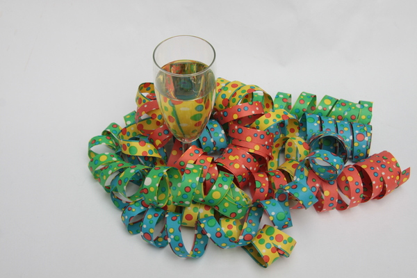 Champagne and streamers: Glass of champagne with coulorfull paper streamers