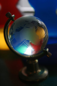 colorful world: a glass globe with some colored decors giving it accents.