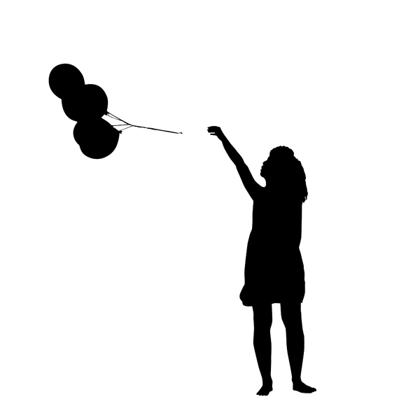Silhouette girl with balloons: a girl letting the balloons get away
