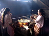 rural kitchen: Indian women cooking a communal meal in a rural village in Carcha, Guatemala