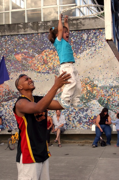 playing bkb: Father shows his daugther how to play baaketball.