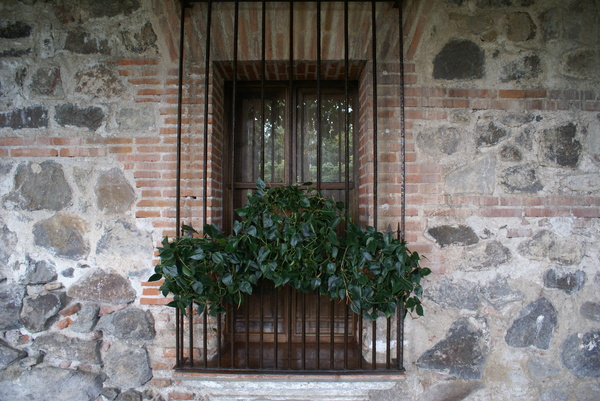 colonial window: A closed window in a colonial house in Antigua Guatemala.