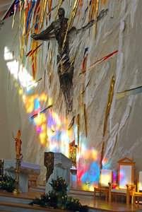 Rainbow in the church: Sunrays coloured by stained glass on the church wall