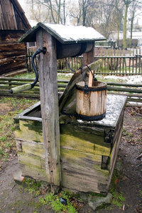 Country well: Old water well with crank drive