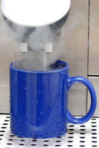 Making the milk coffee 2: Coffe machine and blue pot